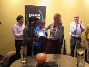 Becca Bowlin presenting Volunteer of the Year to Rashida Black