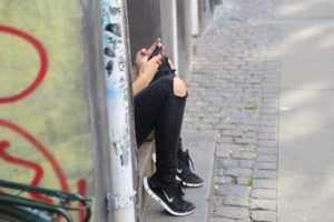 talking-on-phone-adults-running-away